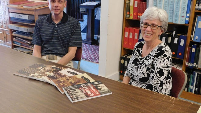 Herkimer County Historical Society Board President Jeff Steele and Executive Director Sue Perkins are shown with the books Perkins has worked on during her tenure at the society. She plans to retire at the end of the year. DONNA THOMPSON/TIMES TELEGRAM