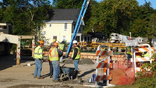Crews on Tuesday were pouring the deck for the new Richfield Street Bridge in Ilion. DONNA THOMPSON / TIMES TELEGRAM