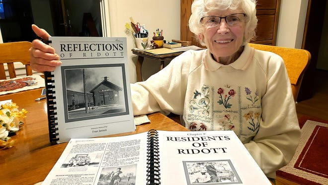 "Fran Jansen holds a copy of her latest book,  ""Reflections of Ridott,"" on Monday, Nov. 9, 2020, at her home near Ridott."