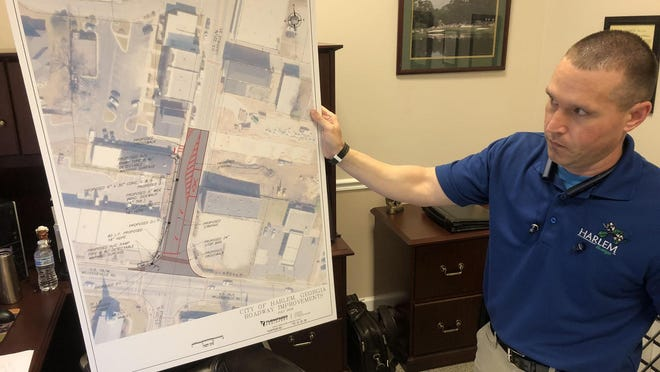Harlem City Manager Brett Cook shows a rendering of a proposed improvement to North Louisville Street to ease increased traffic flow.