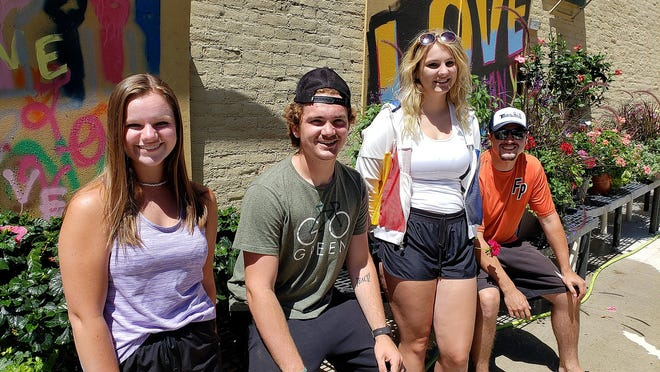 """Alyson Garnhart, from left, Jack Heimer, Anika Fosler and Jayden Middlesteadt are known as the """"Dream Team"""" because they take care of plants in downtown Freeport. They're shown here on Wednesday, June 24, 2020, as they take a break from their jobs at Deininger Floral in Freeport."""