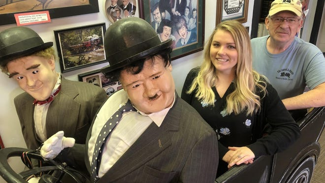 Harlem Downtown Development Director Kennedy Sammons and Gary Russeth, a volunteer at the city's Laurel and Hardy Museum, stand in one of the museum's exhibits during the 2018 Oliver Hardy Festival.