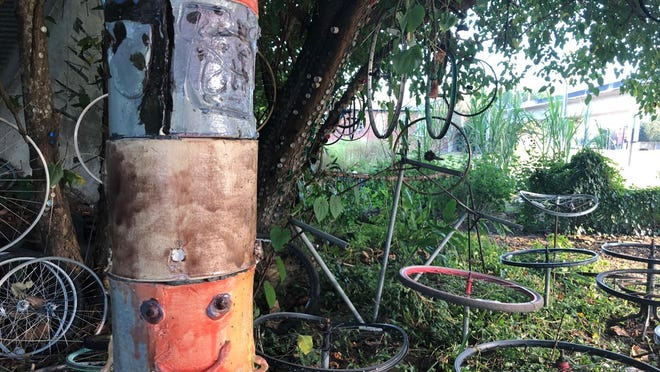 A children's sculpture from the cultural arts center is now at home in Jane's Boundary Street garden.