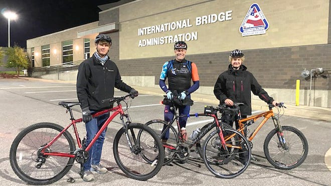 Paul McMullen (center) started his endurance biking challenge early Friday morning near the International Bridge in Sault Ste. Marie. McMullen was joined at the start by Kale and Haydn Jones of the Sault.