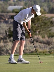 Ian Gilligan putts Tuesday at Eagle Valley West