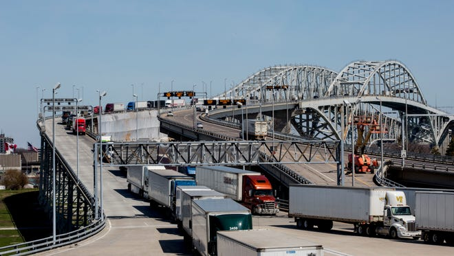 Vehicles travel across the Blue Water Bridges Wednesday, April 27, 2016 in Port Huron. MDOT is applying for $50 million in federal grant money to fund the delayed plaza expansion project.