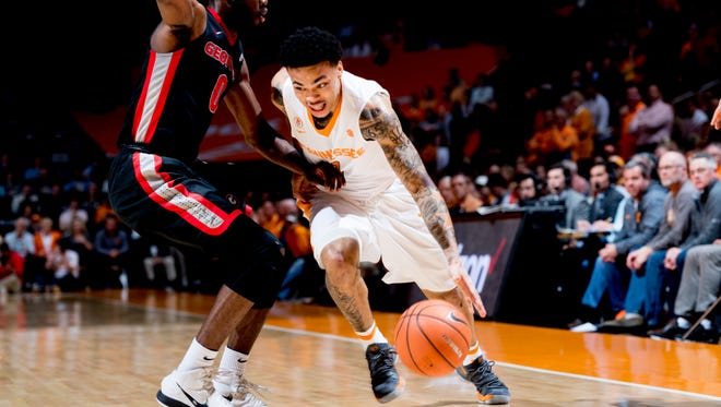 Tennessee guard Lamonte Turner (1) dribbles past Georgia guard William Jackson II (0) during a game between Tennessee and Georgia at Thompson-Boling Arena in Knoxville, Tennessee on Friday, March 2, 2018.