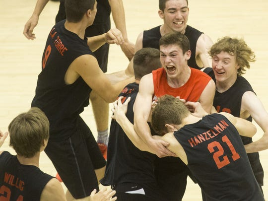Hempfield celebrates after winning the championship. Hempfield defeats Penn Manor 3-2 to win the PIAA Class AAA boys' volleyball state championship title at Penn State University's Rec Hall in State College, Saturday, June 11, 2016.