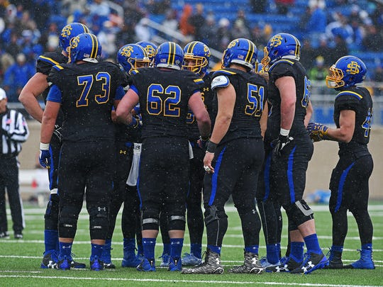 SDSU players huddle during playoff game against Villanova