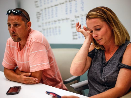 "On Tuesday, June 6, 2017, Travis Jordan, left, Tara Dilk become emotional as they listen to a conversation that Dilk recorded with Robert Keck, founder and president of Chart Properties. ""I have to start doing what's right for my family,"" Dilk said in the recording. ""I have to get my marriage put back together. I have to get my kids a bedroom. This has just destroyed us."""