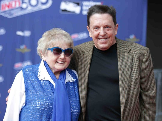 Eva Mozes Kor and her son, Alex, walk the red carpet
