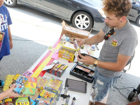 Anthony Sniadowski helps customers at TNT Fireworks at 401 Governors Place in Bear.