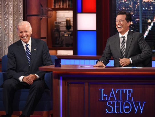Host Stephen Colbert, right, laughs with Vice President