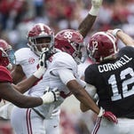 Alabama linebacker Tim Williams (56) and defensive lineman Da'Shawn Hand (9) pressure quarterback David Cornwell during the A-Day game.