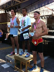 Top male finishers in the Flamingo Run on Saturday in Melbourne are Tyler Roberts (second), Jonathan Campbell (first) and Eric Kieffer (third).