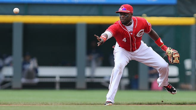Reds second baseman Brandon Phillips tosses the ball to second base for an out Thursday against the Dodgers.