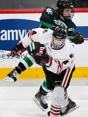 Ryan Poehling (4) of Lakeville North and Marko Reifenberger (22) of Hill Murray collide in the first period of the 2015 Class 2A State Tournament.