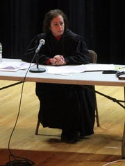 Administrative Law Judge Gail Cookson (left) listens during the public hearing at Middletown High School North Wednesday evening, January 25, 2017, on JCP&L's Monmouth County Reliability Project.