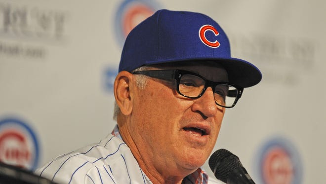 Chicago Cubs manager Joe Maddon speaks during a press conference at the Cubby Bear Lounge near Wrigley Field.