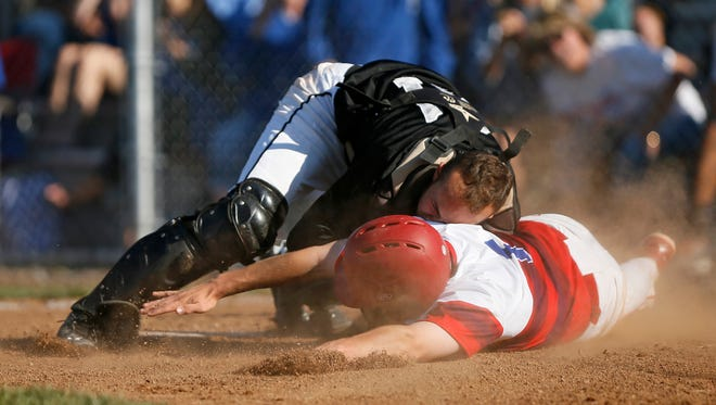 Ryle catcher Marshall Rich tags out Conner's Drew Borman at the plate during the second inning of the Raiders' 7-3 win in a 33rd District semifinal game.