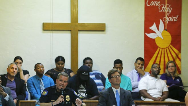 Phoenix Assistant Chief Mike Kurtenbach and  Mayor Greg Stanton speak  during a the Arizona Black Lives Matter campaign town hall meeting Monday, July 18, 2016 in Phoenix, Ariz..