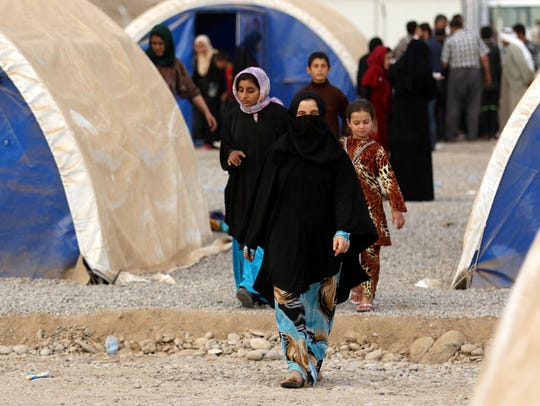 Iraqis who fled the violence in the city of Mosul as