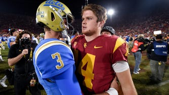 Josh Rose, left, and Sam Darnold are expected to be among the top picks in Thursday's NFL draft.