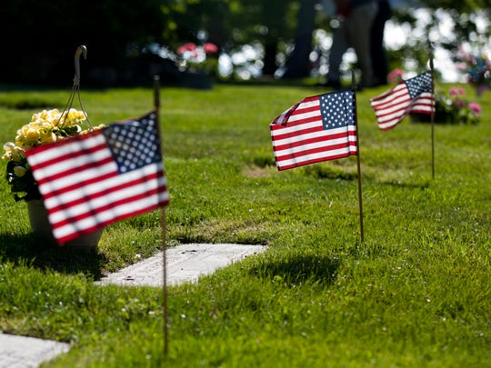 Flags placed by members of American Legion Post 449 Saturday at Riverlawn Cemetery in Marysville.