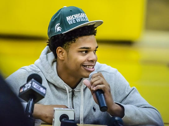 Miles Bridges smiles at an October news conference