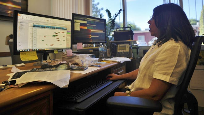 Veronica McDermott is one of the city employees who spearhead the police department's switch in dispatch systems.
