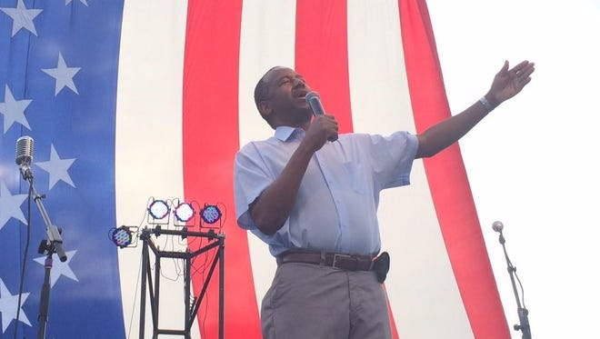 Ben Carson addresses a crowd exceeding 500 people at a family festival that shut down the Court Avenue bridge in downtown Des Moines Saturday evening.