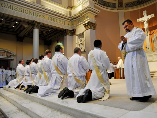 Christiano Nunes da Silva returns to his position with the eight other priests during their ordination ceremony at Cathedral of the Incarnation Saturday, July 26, 2014 in Nashville, TN.