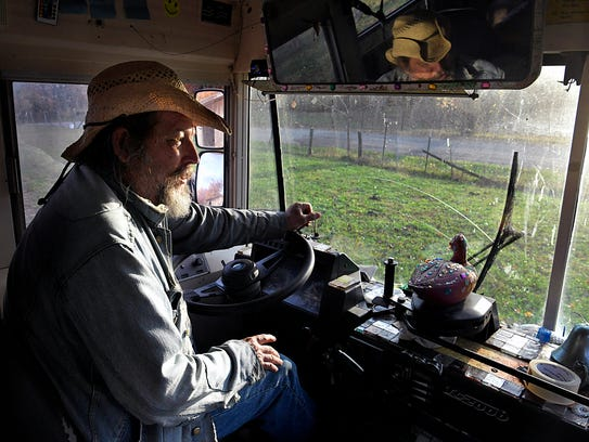 Jack Stoddart, a man more well known as Hippie Jack, drives the 'Hippie Bus' down a rural road delivering food and clothing to the needy on the Cumberland Plateau. Stoddart received a school bus as a donation from Cooper Recycling and repainted the bus to use for his mobile pantry outreach program which gives food and clothing to the needy in the ex-coal mining communities on the Cumberland Plateau.