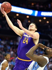 Lipscomb guard Garrison Mathews (24) goes up for the