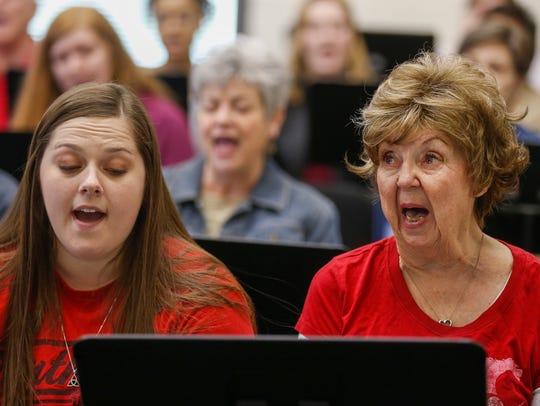Raeanna Duncan, left, and Beverly Burchett sing during