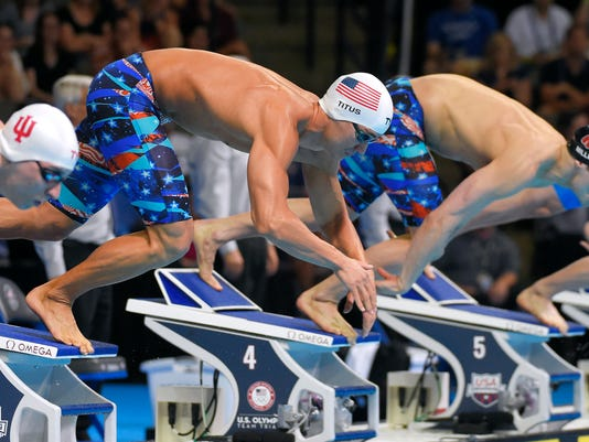 Marcus Titus, second left, dives with others at the start of a men's 100-meter breaststroke semifinal at the U.S. Olympic swimming trials, Sunday, June 26, 2016, in Omaha, Neb. (AP Photo/Mark J. Terrill)