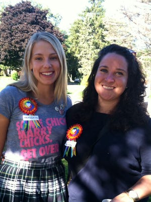 Amanda Ruud McVety (left) organized Sunday's demonstration. She's standing with fellow 2002 classmate Diana Callaghan.