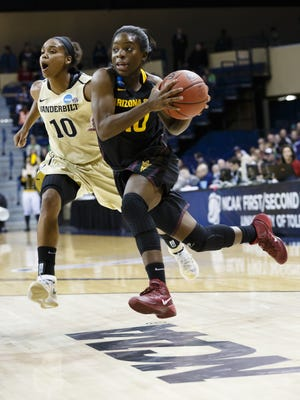 Arizona State guard Promise Amukamara (10) dribbles around Vanderbilt guard Christina Foggie (10) during the second half in a first-round game in the NCAA women's college basketball tournament, Saturday, March 22, 2014, in Toledo, Ohio.
