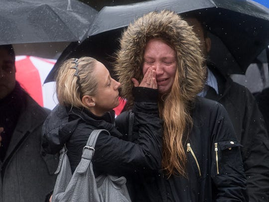 A woman is comforted by her friend as she breaks down