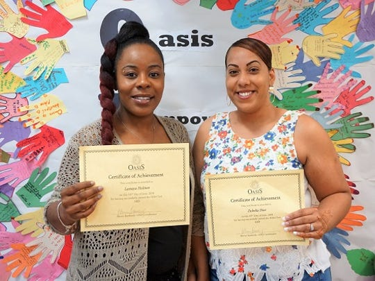 Lamaya Holmes, left, and Zuleika Diaz, two Paterson women who attained their high school diplomas through GED classes at Oasis.