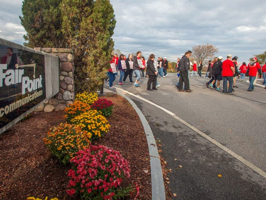 Employees picket outside FairPoint Communications'