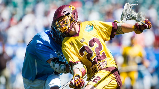 Salisbury University attack Nathan Blondino (22) drives to the crease against Tufts University in the NCAA Divison III Finals on Sunday, May 29, 2016 at Lincoln Financial Field in Philadelphia.