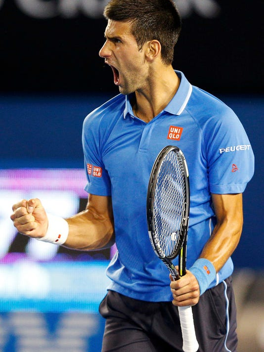 Djokovic of Serbia celebrates a point over Wawrinka of Switzerland during their men's singles semi-final match at the Australian Open 2015 tennis tournament in Melbourne
