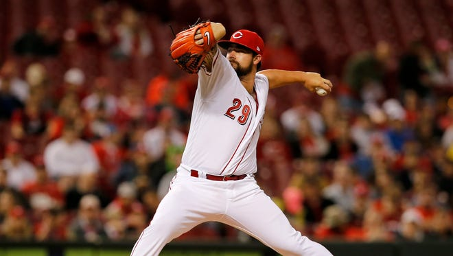 Cincinnati Reds starting pitcher Brandon Finnegan (29) delivers a pitch in the top of the second inning.