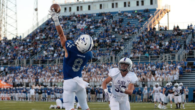 St. Xavier wide receiver Cameron Specht (8) makes a one-handed catch for a touchdown in the first quarter during the high school football game between the Elder Panthers and St. Xavier Bombers, Friday, Sept. 29, 2017, at at St. Xavier High School in Springfield Township, Ohio.