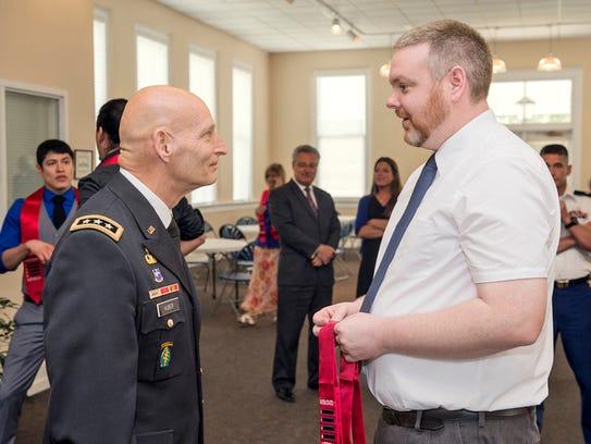 Graduating MTSU student veteran Robert Keller, right,