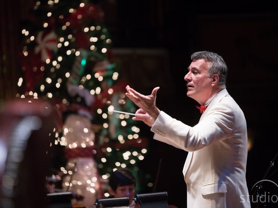 Philharmonic music director Alfred Savia directs the orchestra during a past Christmas performance. Peppermint Pops is Saturday and Sunday and Candy Cane Express Saturday.