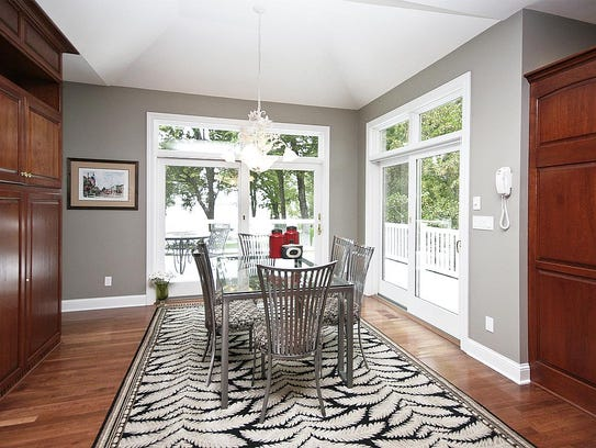 A dining area has plenty of outdoor views at 10836