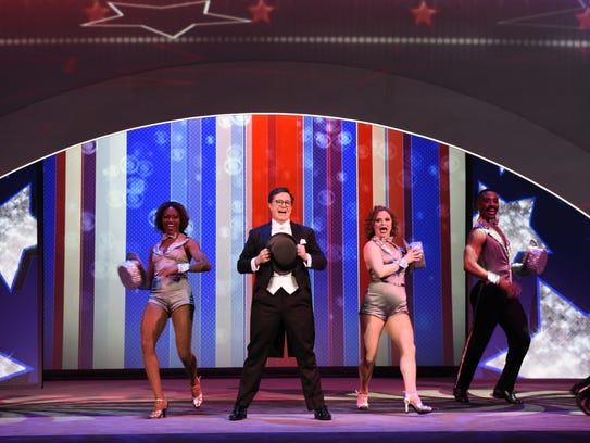 Stephen Colbert performs a musical tribute for advertisers
