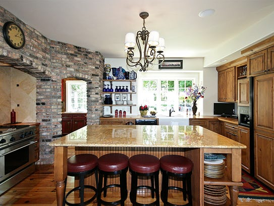 The kitchen features India granite at 9196 Lake Ave.